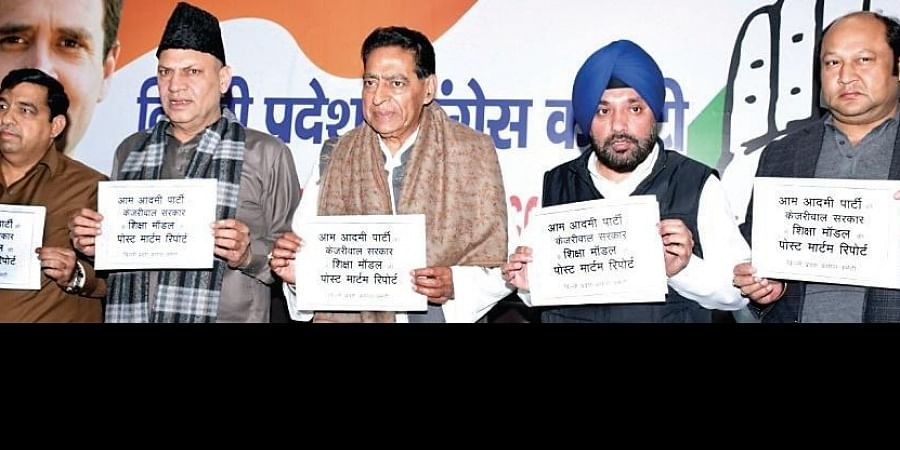DPCC head Subhash Chopra (centre) and party leader Arvinder Singh Lovely release a report on Delhi's education