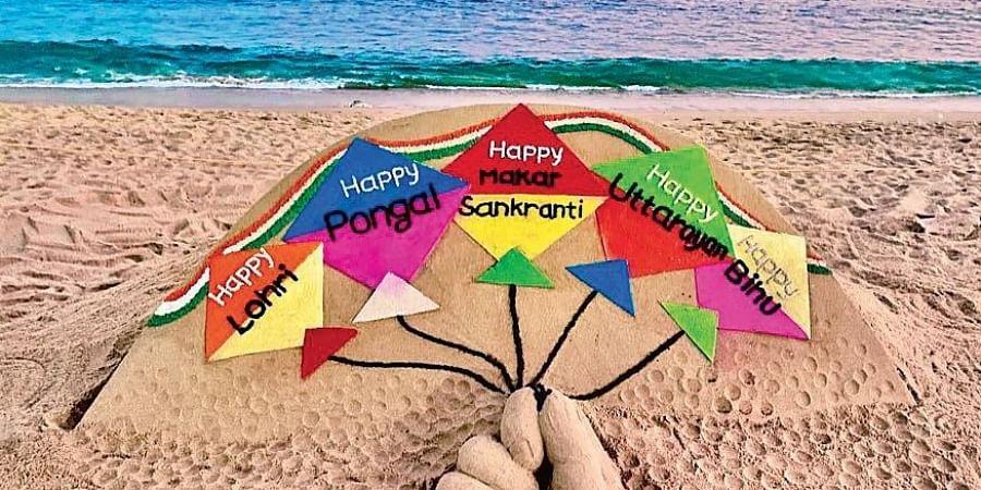 Sand artist Sudarsan Pattnaik conveys his festive wishes through his sculpture on Puri beach on Tuesday