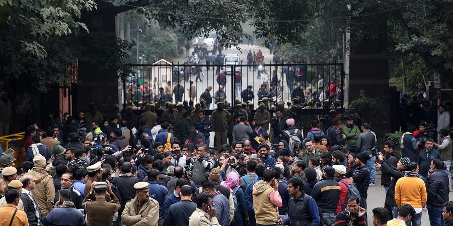 Police personnel guard as students and media are also seen at the main gate of the Jawaharlal Nehru University JNU in New Delhi on Monday January 6 2020. (Photo | Shekhar Yadav/EPS)