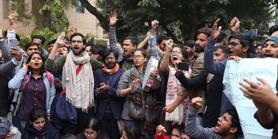 Jamia students shout slogans during a protest against the removal of VC of Jamia Millia outside VC office in New Delhi on Monday