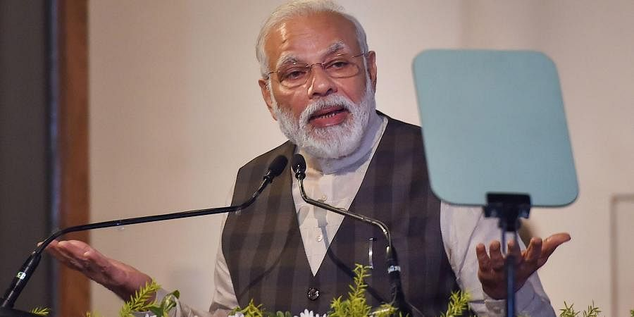 Prime Minister Narendra Modi addresses at restored 'Old Currency Building' during inauguration of 'Ghare-Baire'- an exhibition of art in Kolkata Saturday Jan. 11 2020. (Photo   PTI)