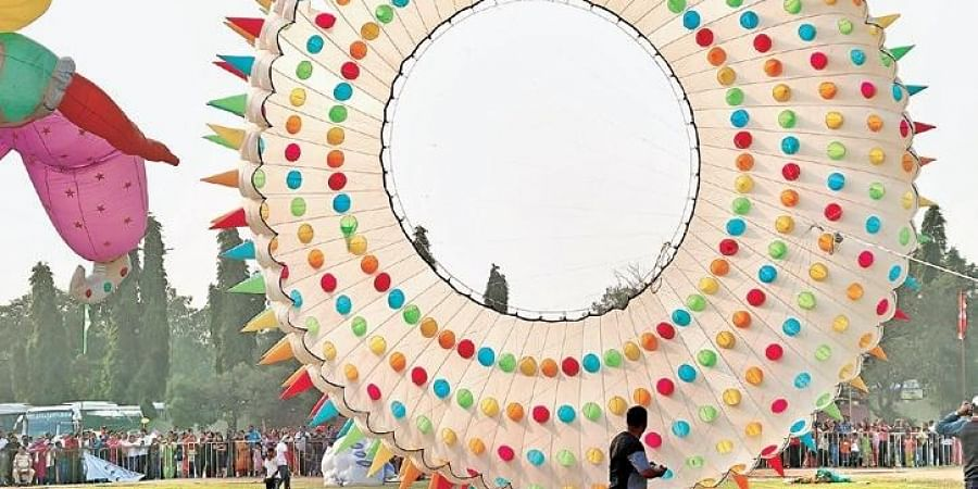 Enthusiasts fly a massive kite during International Kite Festival at Parade Grounds in Hyderabad on Tuesday