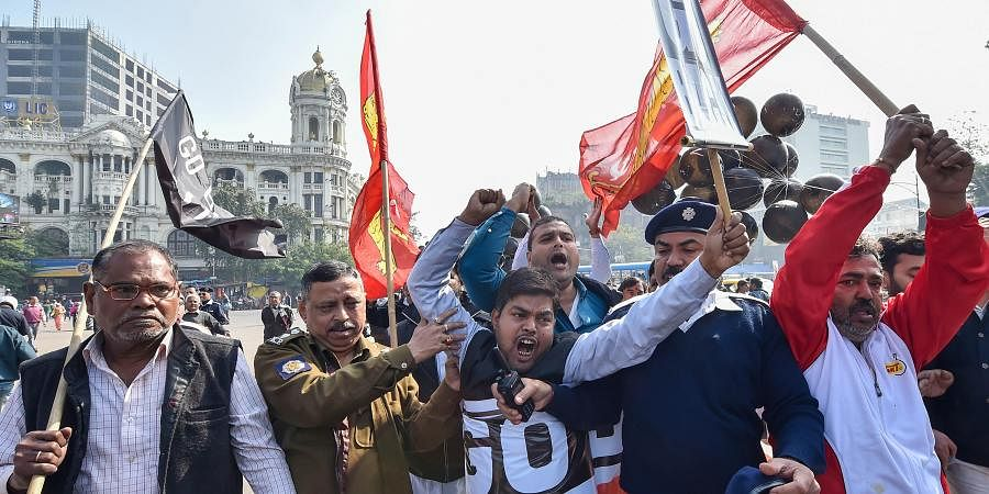 Police personnel attempt to stop activists during a rally to protest against Prime Minister Narendra Modi's visit in Kolkata on Sunday