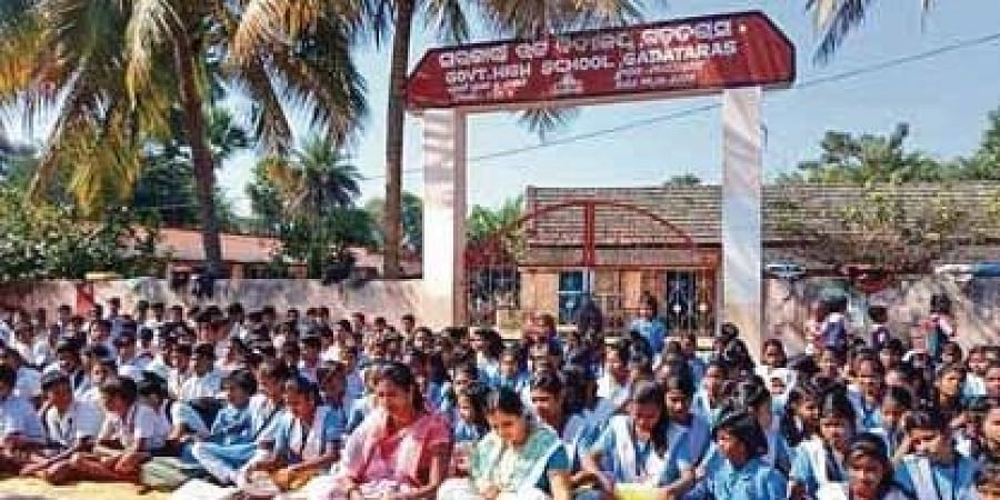 Students and locals staging protest in front of the school in Angul on Tuesday