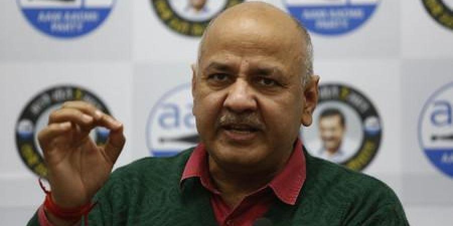 Delhi deputy CM Manish Sisodia addresses a press conference in New Delhi on Tuesday