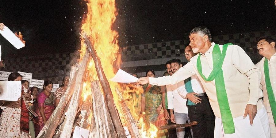 TDP chief N Chandrababu Naidu burns reports of GN Rao panel and BCG in Bhogi bonfire at Benz Circle  in Vijayawada on Tuesday