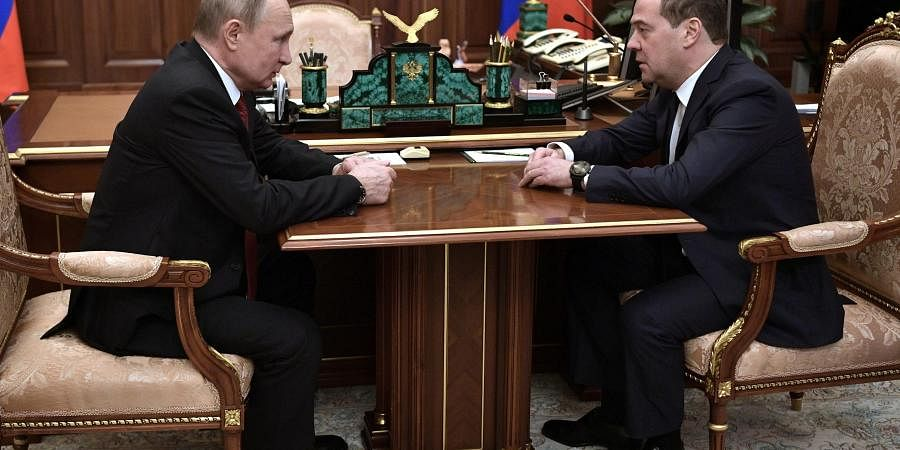 Russian President Vladimir Putin, left, listens to Russian Prime Minister Dmitry Medvedev during their meeting in the Kremlin in Moscow, Jan. 15, 2020.