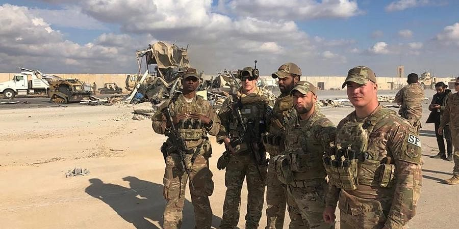US soldiers stand at a site of Iranian bombing at Ain al-Asad air base in Anbar, Iraq