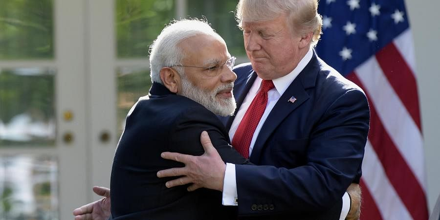 President Donald Trump and Indian Prime Minister Narendra Modi hug while making statements in the Rose Garden of the White House in Washington. (Photo | AP)