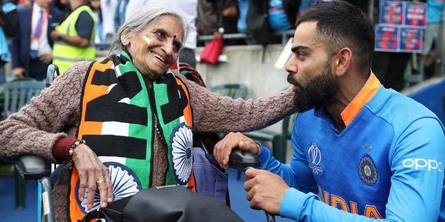 Indian cricket's 'Superfan'Charulata Patel with skipper Virat Kohli.
