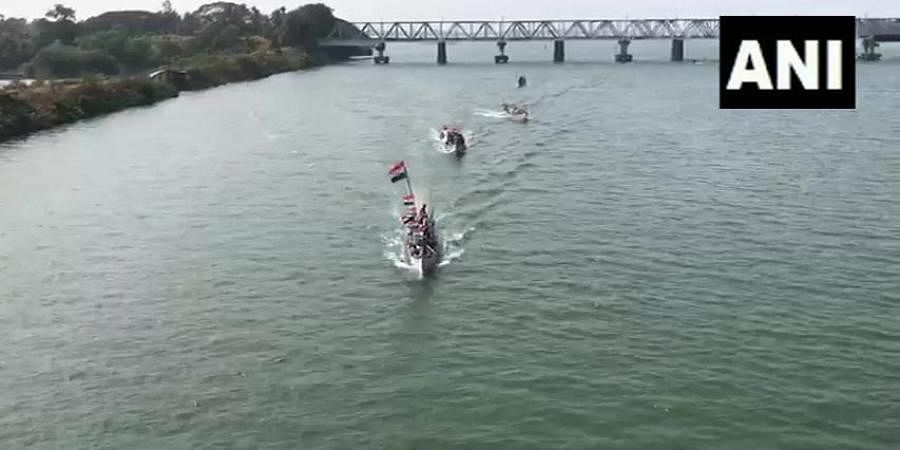 People travelling through boats and steamers decorated with national flags, raised slogans during their journey