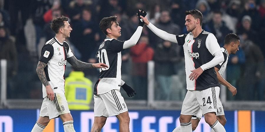 Paulo Dybala, center, celebrates with teammates after scoring his side's third goal of the game during the Italian Cup soccer match between Juventus and Udinese, at the Allianz Stadium in Turin.