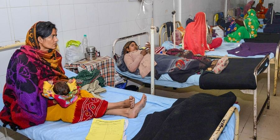 Sick children in the laps of their mothers take treatments at the JK Lon hospital where at least 100 infants have died in the month of December as per reports in Kota district Friday Jan. 3 2020.  (Photo | PTI)