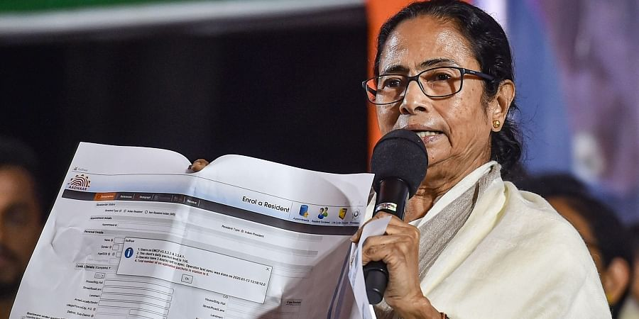 Chief Minister Mamata Banerjee shows a document while addressing TMC Chhatra Parshad TMC students wing students during their protest dharma against CAA NPR and NRC in Kolkata Wednesday Jan. 15 2020.