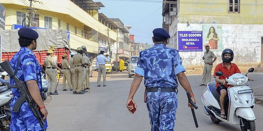 RAF personnel and local police at a street after anti-CAA protests turned violent in several areas in Mangaluru