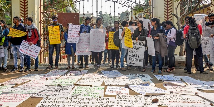 Left-wing students shout slogans outside the central office of Visva-Bharati during a protest against university authorities after a clash between TMCP Left front students in Birbhum district of West Bengal Thursday Jan. 16 2020. (Photo | PTI)