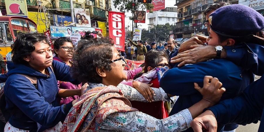 Police detain SUCI activists who were staging a road blockade in support of the trade unions' Bharat Bandh in Kolkata Wednesday.