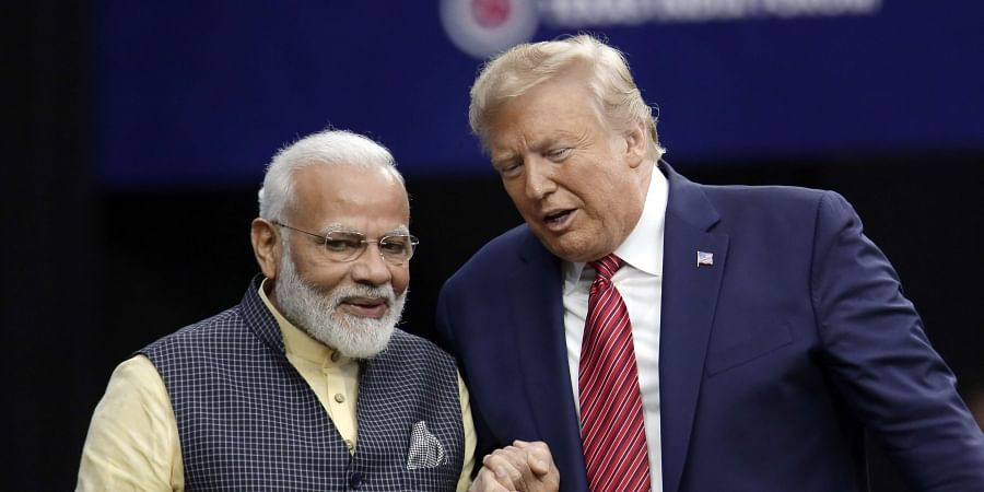 President Donald Trump shakes hands with Indian Prime Minister Narendra Modi during the 'Howdy Modi: Shared Dreams, Bright Futures' event at NRG Stadium, Sunday, Sept. 22, 2019, in Houston. | (Photo | AP)
