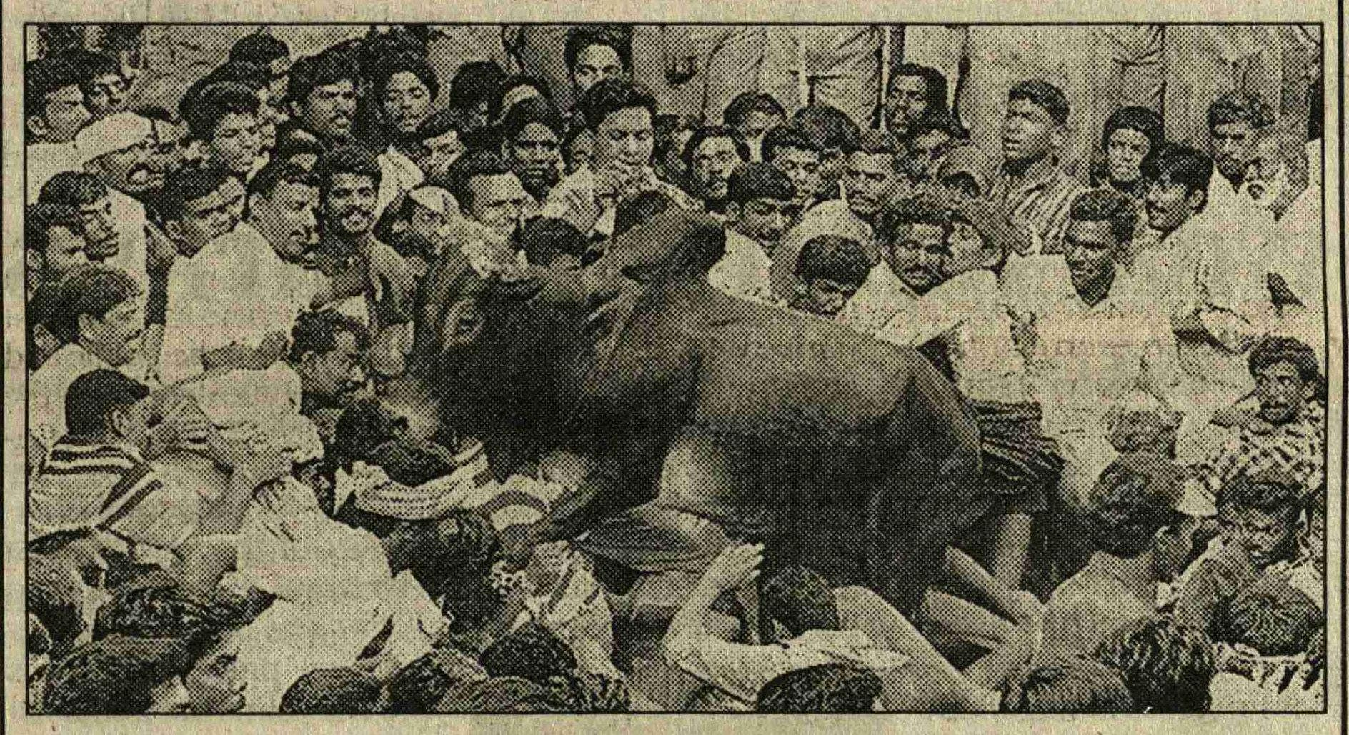 2006: A bull runs wild through a crowd of men trying to tame it in Alanganallur (Photo | EPS)