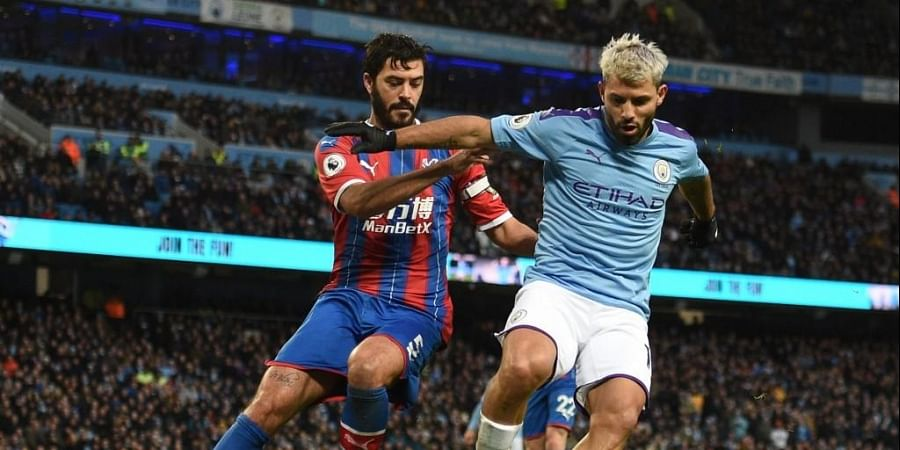 Crystal Palace's English defender James Tomkins (L) vies with Manchester City's Argentinian striker Sergio Aguero during the English Premier League football match between Manchester City and Crystal Palace. (Photo | AP)