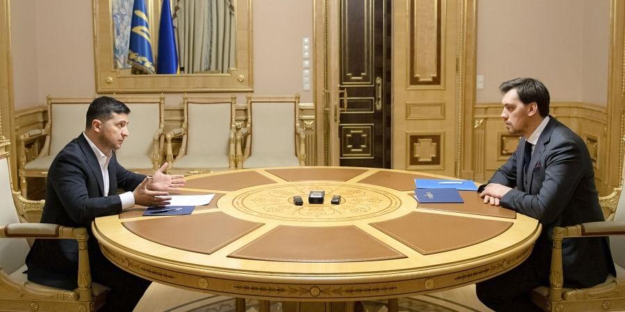 Ukrainian President Volodymyr Zelenskiy, left, talks with Ukraine's Prime Minister Oleksiy Honcharuk in Kyiv, Ukraine. (Photo | AP)