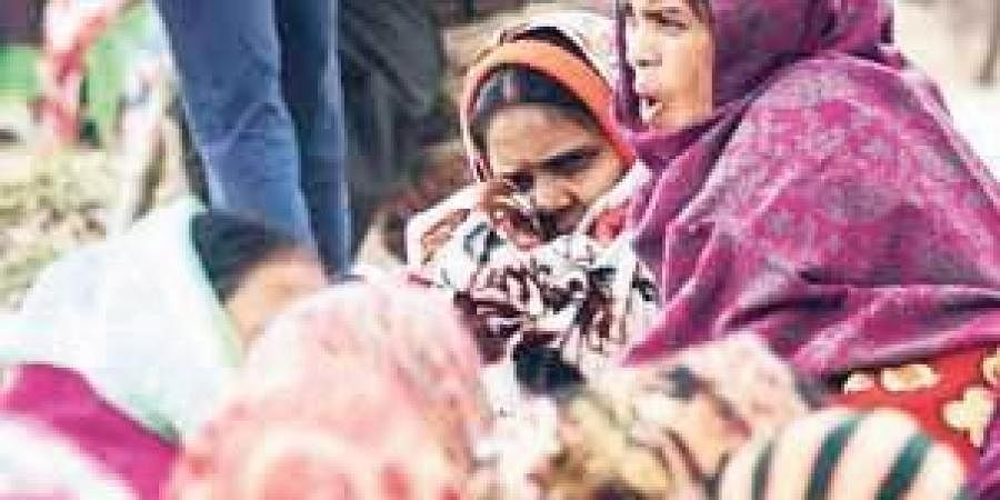 Women wrap themselves in blankets as protection against cold wind in Bhubaneswar on Friday   Biswanath Swain