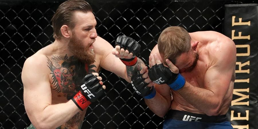 Conor McGregor, left, fights Donald 'Cowboy' Cerrone during a UFC 246 welterweight mixed martial arts bout.