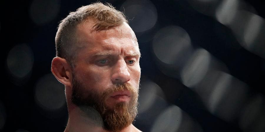 Donald 'Cowboy' Cerrone stands in the ring before fighting Conor McGregor in a UFC 246 welterweight mixed martial arts bout.