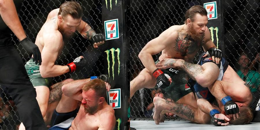 Conor McGregor, top, fights Donald 'Cowboy' Cerrone during a UFC 246 welterweight mixed martial arts bout.