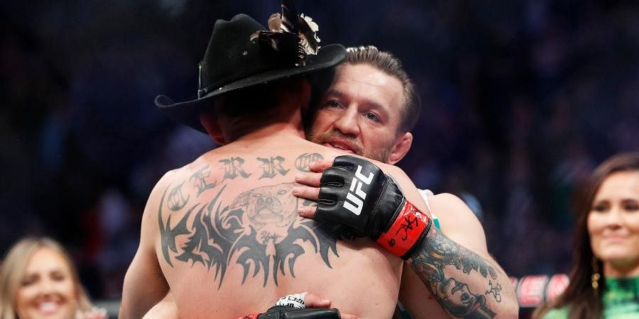 Conor McGregor, rear, embraces Donald 'Cowboy' Cerrone after their UFC 246 welterweight mixed martial arts bout.