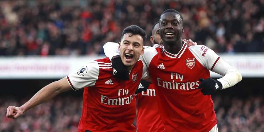 Arsenal's Gabriel Martinelli, left, celebrates scoring his sides first goal of the game with teammate Nicolas Pepe during the English Premier League soccer match between Arsenal and Sheffield United at the Emirates Stadium, London. ( Photo | AP)