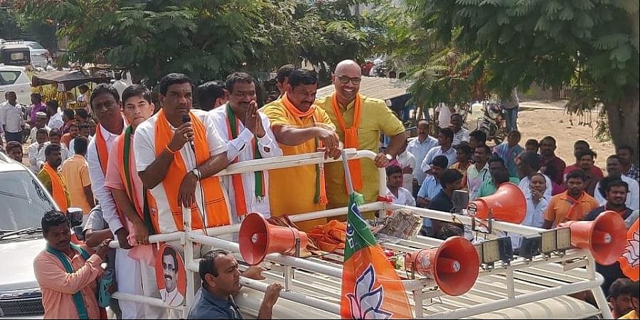 BJP MLA Raja Singh (second from right) and other leaders at an election campaign rally in Nizamabad town on Saturday