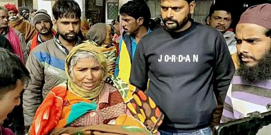 An elderly woman carrying a child at the JK Lon Hospital in Kota on Thursday