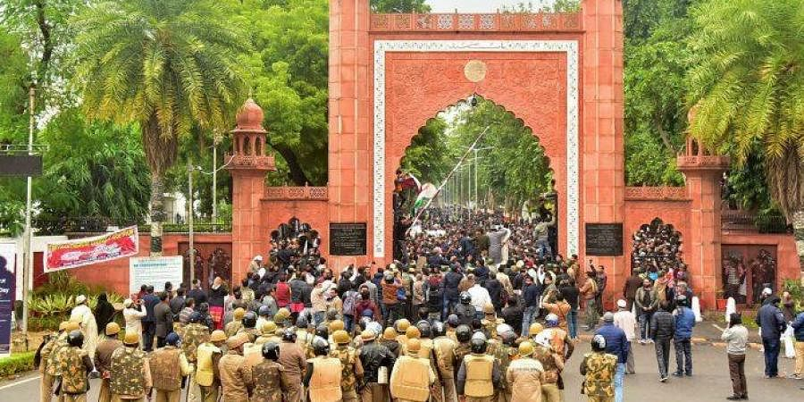 Police personnel stand guard outside Aligarh Muslim University as students protest against the passing of Citizenship Amendment Bill.