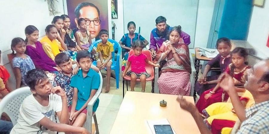 Students taking part in the free English grammar classes conducted at Kamarajapuram in Coimbatore.