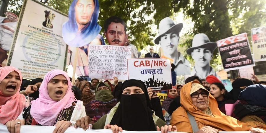 Demonstrators shout slogans during a protest against Citizenship Act at mandi house in New Delhi on Tuesday. (Photo | Parveen Negi/EPS)