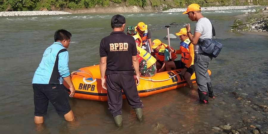 Rescue team prepares to search for victims of bridge break on a river in Kaur district of Bengkulu province in Indonesia