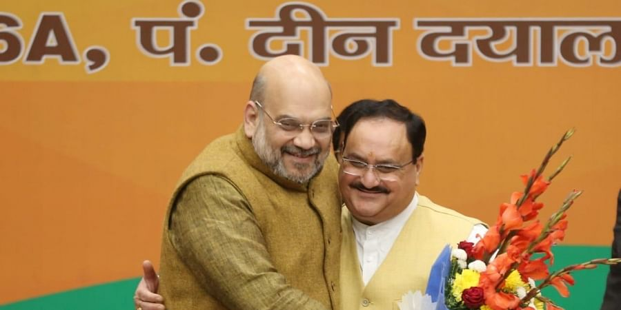 Union Home Minister Amit Shah hugs BJP's national president JP Nadda.
