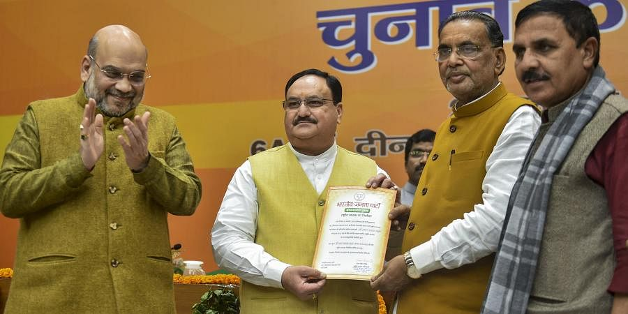 Outgoing BJP president Amit Shah claps as Organisation Poll process incharge Radha Mohan Singh hands over the victory certificate to party leader J P Nadda after he was elected as the next national president of the party in New Delhi Monday Jan. 20 2020.