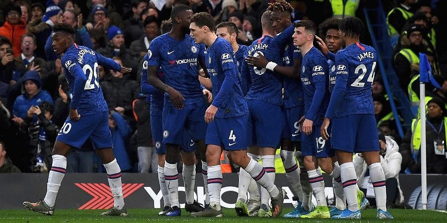 Chelsea's Tammy Abraham, fourth right, celebrates scoring his side's second goal of the game with teammates, during the English Premier League soccer match between Chelsea and Burnley at Stamford Bridge, in London.