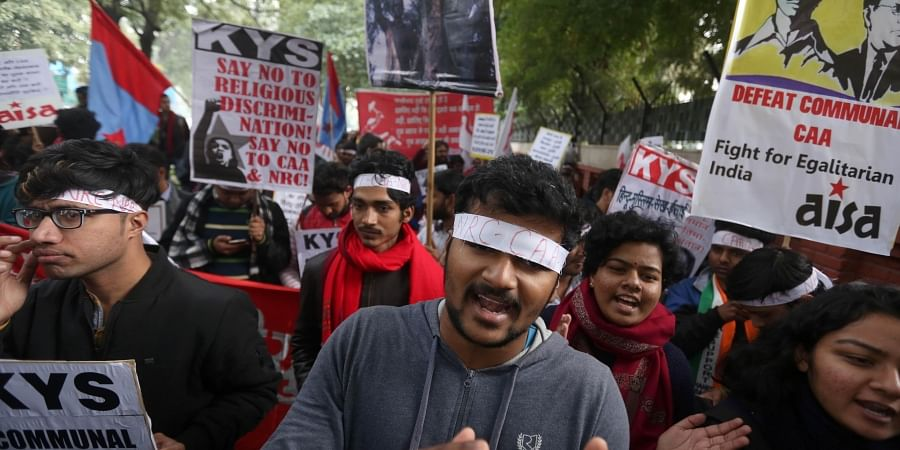Students hold placards as they shout slogans to protest against India's new citizenship law during a demonstration in New Delhi on Monday. (Photo | Shekhar Yadav/EPS)