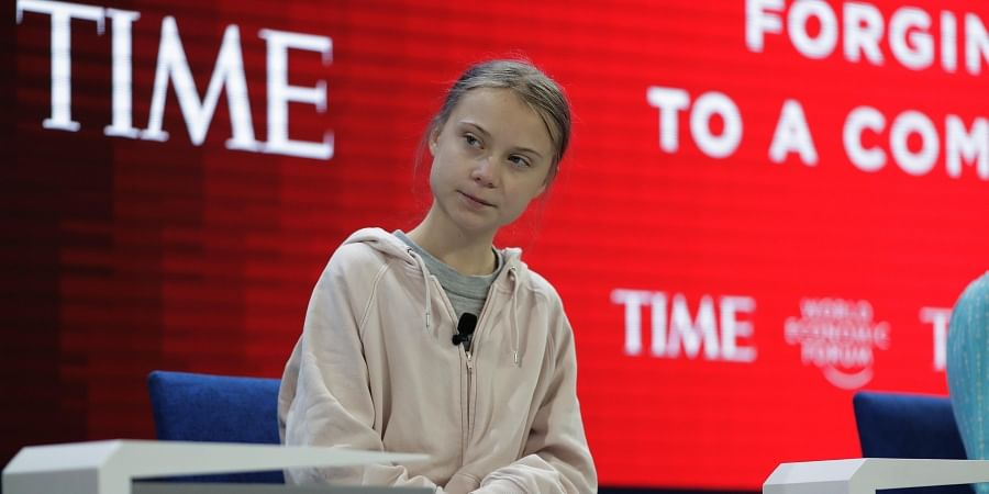 Swedish environmental activist Greta Thunberg takes her seat prior to the opening session of the World Economic Forum in Davos