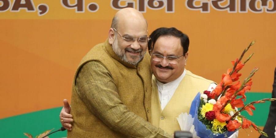 Union Home Minister Amit Shah hugs BJP's national president JP Nadda.