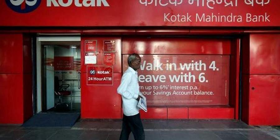 A man walks past the Kotak Mahindra Bank branch in New Delhi.