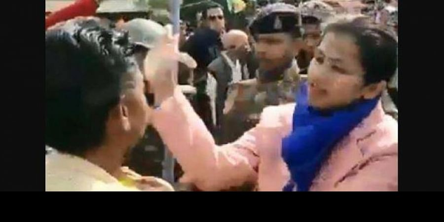 Additional collector Priya Verma taking on some men who were part of the crowd.