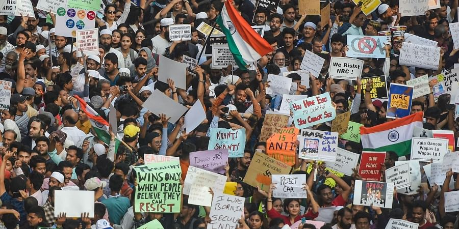 Protesters arrive to participate in a rally against the amended Citizenship Act and NRC, at August Kranti Maidan in Mumbai, Thursday, Dec. 19, 2019.