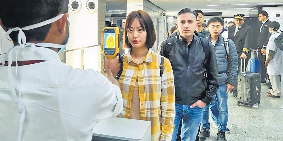 A thermal screeening device checks passengers arriving in India from China and Hong Kong at an airport in Kolkata on Tuesday in view of the outbreak of the novel coronavirus (CoV) in China.