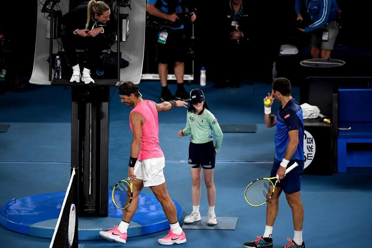 Watch Rafael Nadal Accidentally Hits Ball Girl Plants Kiss To Apologise The New Indian Express