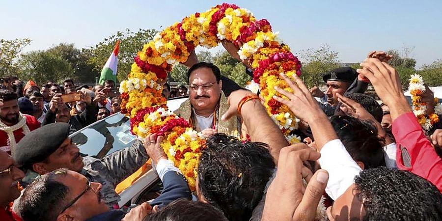 BJP National President JP Nadda being garlanded enroute Agra from Delhi, Thursday, Jan. 23, 2020.