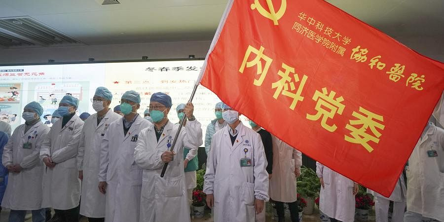 Medical workers of the Union Hospital with the Tongji Medical College of the Huazhong University of Science and Technology in Wuhan participate in a ceremony to form an 'assault team' to battle against a coronavirus epidemic in Wuhan in central China's Hubei Province, Jan. 23, 2020.